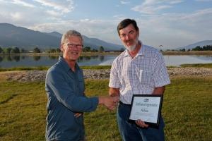 Fellow Birkebeiner member,  Jim Gargan, left, presents Phil Evans with his 30 year Bush Search & Rescue Victoria Award